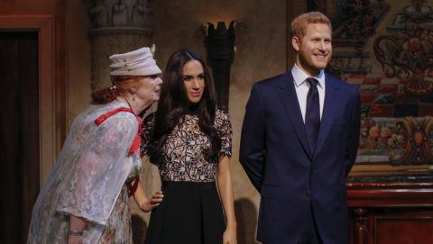 NEW YORK, NY - MAY 19: Tourists pose next to wax sculptures of Meghan Markle and Prince Harry as they attend a royal wedding watch party at the Madame Tussauds wax museum on May 19, 2018 in New York, New York. (Photo by Kena Betancur/Getty Images)