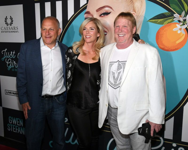 """LAS VEGAS, NV - JUNE 27:  (L-R) Oakland Raiders President Marc Badain, his wife Amy Badain and Raiders owner Mark Davis attend the grand opening of the """"Gwen Stefani - Just a Girl"""" residency at Planet Hollywood Resort & Casino on June 27, 2018 in Las Vegas, Nevada.  (Photo by Ethan Miller/Getty Images)"""