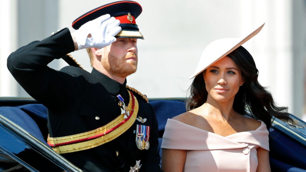 LONDON, UNITED KINGDOM - JUNE 09: (EMBARGOED FOR PUBLICATION IN UK NEWSPAPERS UNTIL 24 HOURS AFTER CREATE DATE AND TIME) Prince Harry, Duke of Sussex and Meghan, Duchess of Sussex travel down The Mall in a horse drawn carriage during Trooping The Colour 2018 on June 9, 2018 in London, England. The annual ceremony involving over 1400 guardsmen and cavalry, is believed to have first been performed during the reign of King Charles II. The parade marks the official birthday of the Sovereign, even though the Queen's actual birthday is on April 21st. (Photo by Max Mumby/Indigo/Getty Images)