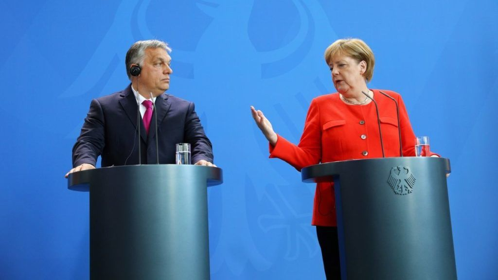 German Chancellor Angela Merkel (R) and Hungarian Prime Minister Viktor Orban give a joint press conference following a meeting on July 5, 2018 in Berlin. Angela Merkel and Viktor Orban hold talks, days after the German chancellor made key border policy concessions to hardliners who have embraced the Hungarian leader's anti-migrant stance. / AFP PHOTO / Omer MESSINGER