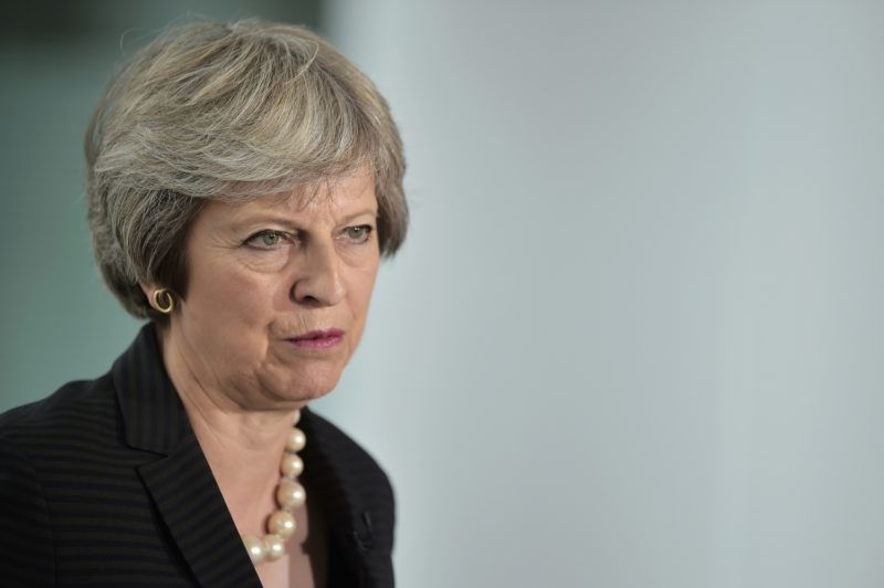 Britain's Prime Minister Theresa May delivers a keynote speech on Brexit at Waterfront Hall in Belfast, Northern Ireland, on July 20, 2018. With a trip to Northern Ireland this week, May began a tour of Britain to convince voters to back her blueprint for close economic ties with the bloc after Brexit next March. / AFP PHOTO / POOL / Charles McQuillan