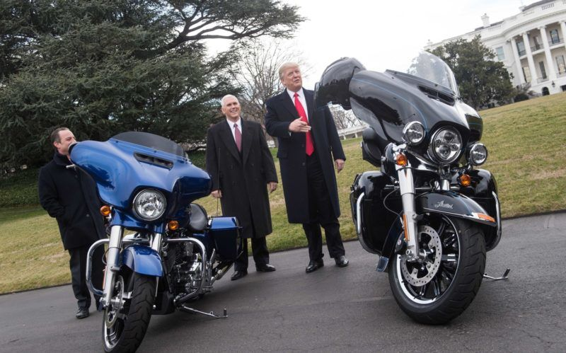 US President Donald Trump jokes with reporters after greeting Harley Davidson executives and union representatives on the South Lawn of the White House in Washington, DC, on February 2, 2017 prior to a luncheon with them. / AFP PHOTO / NICHOLAS KAMM