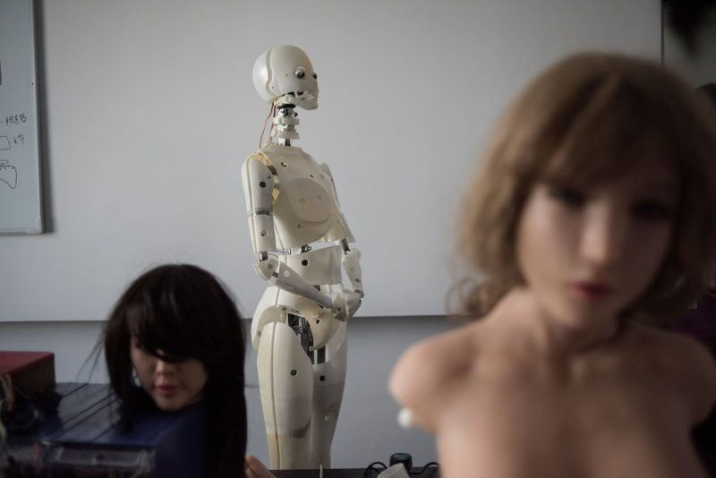 """This photo taken on February 1, 2018 shows robots in a lab of a doll factory of EXDOLL, a firm based in the northeastern Chinese port city of Dalian.With China facing a massive gender gap and a greying population, a company wants to hook up lonely men and retirees with a new kind of companion: """"Smart"""" sex dolls that can talk, play music and turn on dishwashers. / AFP PHOTO / FRED DUFOUR / TO GO WITH China-sex-lifestyle, FOCUS by Joanna CHIU"""