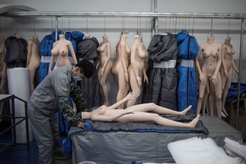 """EDITORS NOTE: Graphic content / This photo taken on February 1, 2018 shows a worker preparing a silicone doll at a factory of EXDOLL, a firm based in the northeastern Chinese port city of Dalian.With China facing a massive gender gap and a greying population, a company wants to hook up lonely men and retirees with a new kind of companion: """"Smart"""" sex dolls that can talk, play music and turn on dishwashers. / AFP PHOTO / FRED DUFOUR / TO GO WITH China-sex-lifestyle, FOCUS by Joanna CHIU"""