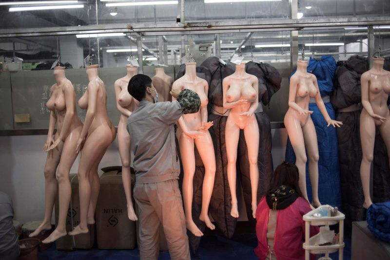 """EDITORS NOTE: Graphic content / This photo taken on February 1, 2018 shows a worker preparing silicone dolls at a factory of EXDOLL, a firm based in the northeastern Chinese port city of Dalian.With China facing a massive gender gap and a greying population, a company wants to hook up lonely men and retirees with a new kind of companion: """"Smart"""" sex dolls that can talk, play music and turn on dishwashers. / AFP PHOTO / FRED DUFOUR / TO GO WITH China-sex-lifestyle, FOCUS by Joanna CHIU"""