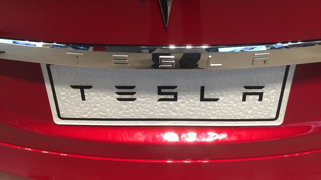 """--FILE--View of a logo of Tesla at a dealership store of Tesla in Wuhan city, central China's Hubei province, 9 June 2018.    Tesla Chief Executive Officer (CEO) Elon Musk said Tuesday (12 June 2018) that his company is going to slash 9 percent of its workforce to keep it profitable and sustainable. In an email to Tesla staff, Musk said that the company is conducting a comprehensive, across-the-board organizational restructuring. """"Tesla has grown and evolved rapidly over the past several years, which has resulted in some duplication of roles and some job functions that, while they made sense in the past, are difficult to justify today,"""" he said."""
