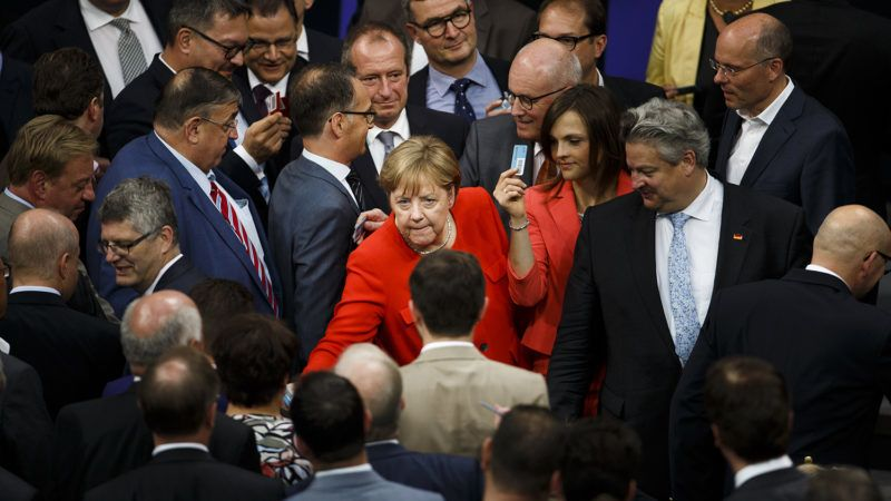 dpatop - 05 July 2018, Germany, Berlin: German Chancellor Angela Merkel, leader of the CDU, casts her vote during the plenary session of the German Bundestag. Photo: Carsten Koall/dpa