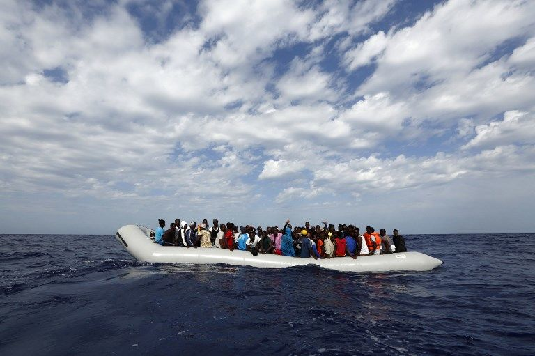 """HANDOUT - A handout picture made available on 02 May 2015 shows 105 refugees on a rubber raft waiting to board the 'Phoenix,'a ship belonging to the Migrant Offshore Aid Station (MOAS), off the shores of the island of Lampedusa, Italy, 04 October 2014. MOAS was founded by Regina Catrambone and her husband Christopher, from Italy and the USA respectively, as the first privately funded offshore refugee aid station. The couple have rescued around 3,000 refugees from drowning in the Mediterranean in the past year. MOAS emphasizes that the organization does not personally transport refugees, but instead tracks down their boats when they are in distress and provides first aid in consultation with the Italian and Maltese navies. Photo:DARRINZAMMITLUPI/MOAS.EU/dpa (ATTENTIONEDITORS:Editorial use only and with mandatory source credit.Source: Darrin Zammut Lupi/MOAS.EU/dpa"""")- MALTAOUT, MLTOUT, NOACCESSMALTA"""