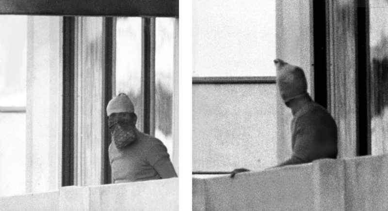 Two masked Arabian terrorists on the balcony of the Israeli team accommodation in the Olympic village of the Munich Summer Olympics, on 5 September 1972. The terrorists of the group 'Black September' had attacked the Israeli accommodation in the Olympic village, killed two Israelis and took nine hostages in the morning of 5th September. All nine hostages, five terrorists, and a Munich police officer lose their lives during the failed operation at the military airport.