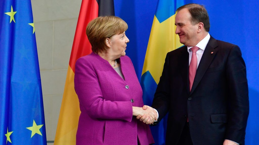 German Chancellor Angela Merkel and Sweden's Prime Minister Stefan Lofven shake hands following a joint press conference on March 16, 2018 at the Chancellery in Berlin. / AFP PHOTO / John MACDOUGALL