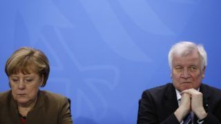 (FILES) In this file photo taken on April 14, 2016, German Chancellor Angela Merkel (L) and then Bavarian state premier and leader of the conservative Christian Social Union (CSU) Horst Seehofer give a press conference at the Chancellery in Berlin. German Chancellor Angela Merkel's future hangs in the balance on July 1, 2018, as her conservative coalition allies choose between accepting a European compromise on migration or exploding her fourth government months into its term. Interior Minister Horst Seehofer in June issued the veteran leader an unprecedented ultimatum, saying he would begin turning away asylum-seekers already registered in other European nations from July 1 unless she struck alternative deals.  / AFP PHOTO / ODD ANDERSEN