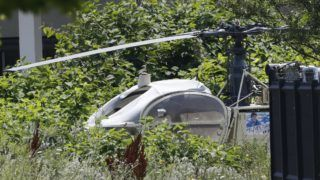 This picture taken on July 1, 2018 in Gonesse, north of Paris shows a French helicopter Alouette II abandoned by French armed robber Redoine Faid after his escape from prison in Reau. / AFP PHOTO / GEOFFROY VAN DER HASSELT