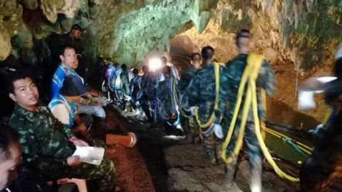 """This photo taken and released by the Royal Thai Navy on July 2, 2018 shows a Thai soldiers carrying cables inside Tham Luang cave at the Khun Nam Nang Non Forest Park in the Mae Sai district of Chiang Rai province as the rescue operation continues for a missing children's football team and their coach. Classmates of 12 boys trapped in a flooded Thai cave spoke of their hopes for a miracle rescue on July 2, as divers inched through thick mud and water towards an air pocket where the group is believed to be.  / AFP PHOTO / ROYAL THAI NAVY / ROYAL THAI NAVY / -----EDITORS NOTE --- RESTRICTED TO EDITORIAL USE - MANDATORY CREDIT """"AFP PHOTO / ROYAL THAI NAVY"""" - NO MARKETING - NO ADVERTISING CAMPAIGNS - DISTRIBUTED AS A SERVICE TO CLIENTS"""