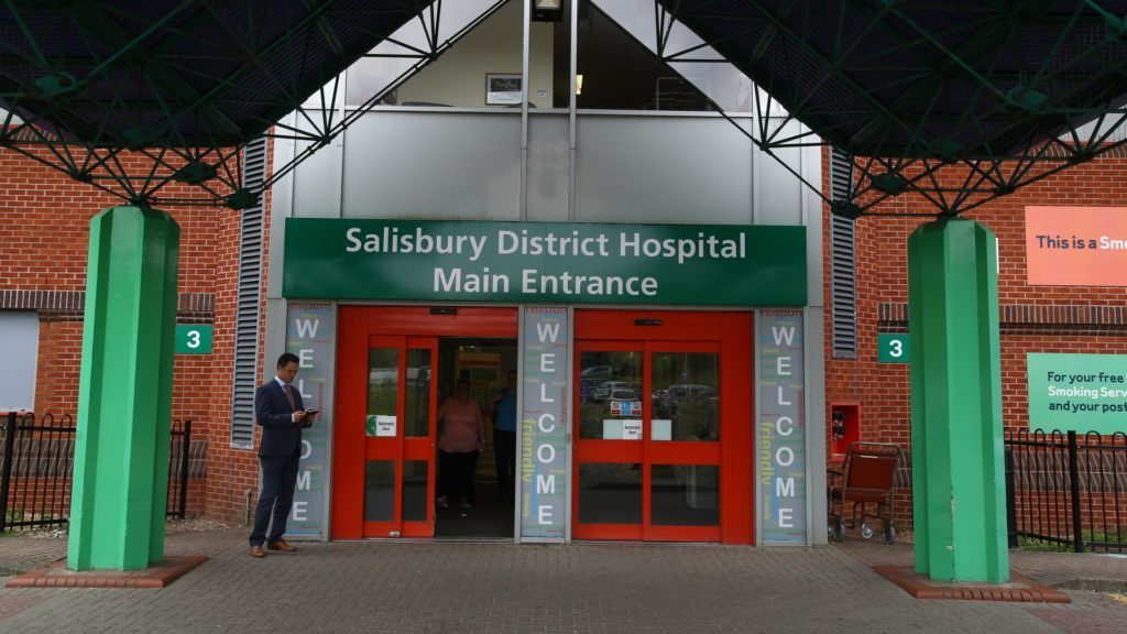 """A general view shows the main entrance to Salisbury District Hospital in Salisbury, southern England, on July 4, 2018 where a man and a woman are in critical condition after exposure to an unknown substance and being found unconcious at a house in Amesbury under circumstances that has sparked a major incident and investigation. Two people have been hospitalised in a critical condition for exposure to an """"unknown substance"""" in the same British city where former Russian spy Sergei Skripal and his daughter were poisoned with a nerve agent earlier this year. British police declared a """"major incident"""" after the couple, a man and a woman in their 40s, were discovered unconscious at a house in a quiet, newly-built area in Amesbury.  / AFP PHOTO / Geoff CADDICK"""