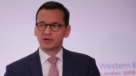 Poland's Prime Minister Mateusz Morawiecki takes part in a press conference during the Western Balkans Summit 2018 at Lancaster House in London, on July 10, 2018. / AFP PHOTO / Tolga AKMEN
