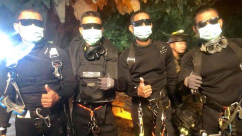 """This handout photo taken by the Royal Thai Navy late on July 10, 2018 shows the last four Thai Navy SEALs giving a thumbs up after exiting safely from the Tham Luang cave in Khun Nam Nang Non Forest Park in Mae Sai district, Chiang Rai province following the rescue of the remaining four boys and their coach. Thailand celebrated the successful mission to free 12 boys and their football coach from a cave on July 11, with the nation heaping praise on the rescue team as the triumphant tagline """"Hooyah"""" pinballed across social media.  / AFP PHOTO / ROYAL THAI NAVY / Handout / -----EDITORS NOTE --- RESTRICTED TO EDITORIAL USE - MANDATORY CREDIT """"AFP PHOTO / ROYAL THAI NAVY"""" - NO MARKETING - NO ADVERTISING CAMPAIGNS - DISTRIBUTED AS A SERVICE TO CLIENTS"""