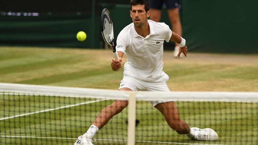 Serbia's Novak Djokovic returns against Spain's Rafael Nadal during the continuation of their men's singles semi-final match on the twelfth day of the 2018 Wimbledon Championships at The All England Lawn Tennis Club in Wimbledon, southwest London, on July 14, 2018. / AFP PHOTO / Glyn KIRK / RESTRICTED TO EDITORIAL USE