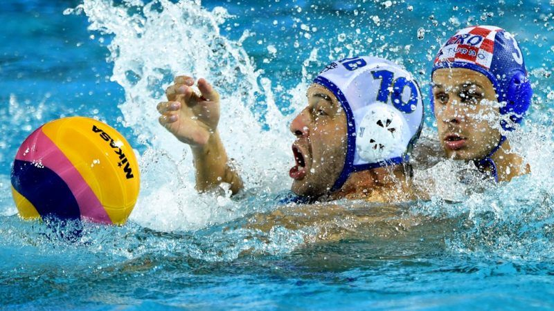 Croatia's Loren Fatovic  (R) vies with Serbia's  Filip Filipovic (L)  during a semifinal water polo match between Croatia and Serbia at the FINA2017 world championships on July 27, 2017, in the Hajos Alfred swimming pool in Budapest. / AFP PHOTO / ATTILA KISBENEDEK