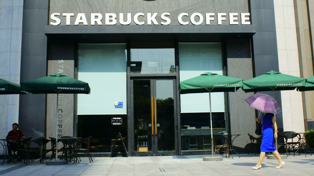 --FILE--A pedestrian walks past a cafe of Starbucks Coffee in Yichang city, central China's Hubei province, 23 June 2016.  According to information from Starbucks China, the company will recall its stainless steel straws, which are sold as cup accessories, in mainland China. A report from General Administration of Quality Supervision, Inspection and Quarantine of China showed that Starbucks has filed its recall plan at the administration, stating that the recalled stainless steel straws were made between September 2013 and March 2016 and the total number recalled in mainland China was 54,457. Starbucks said that this recall is a preventive measure. Due to the hard texture of the stainless steel straw, customers, especially children, might be injured if any accident during use. Basing on safety consideration, the company decided to voluntarily recall those stainless steel straws.