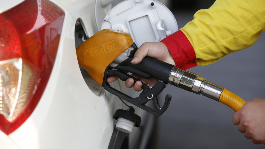 --FILE--A Chinese worker refuels a car at a gas station in Xuyi county, Huai'an city, east China's Jiangsu province, 8 June 2018.  China will reduce the retail prices of gasoline and diesel from Tuesday (26 June 2018), the second cut this month, the National Development and Reform Commission (NDRC) announced Monday. The retail prices of gasoline and diesel will both go down by 55 yuan (about 8.41 U.S. dollars), according to the NDRC. Under the current pricing mechanism, if international crude oil prices change by more than 50 yuan per tonne and remain at that level for 10 working days, the prices of refined oil products such as gasoline and diesel in China are adjusted accordingly. The NDRC has asked major Chinese oil companies, including China National Petroleum, China Petrochemical, and China National Offshore Oil, to ensure stable supply and pricing. The NDRC said it would closely monitor the effects of the current pricing mechanism and make changes in response to global fluctuations. The price monitoring center under the NDRC said it expects international crude prices to remain volatile in the short term, and that attention should be paid to OPEC crude oil supplies and impacts from geopolitical conflicts in the Middle East.