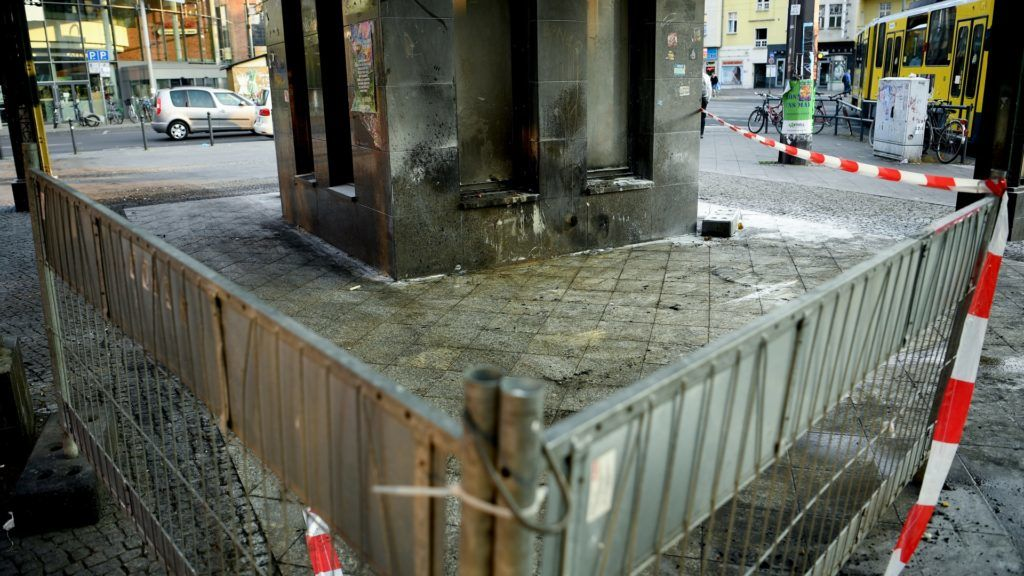 dpatop - 23 July 2018, Germany, Berlin: Burn marks remain at Cajamarcaplatz near Schoeneweide train station after an unidentified attacker dowsed two homeless men in liquid and set them on fire the night before. Photo: Britta Pedersen/dpa-Zentralbild/dpa