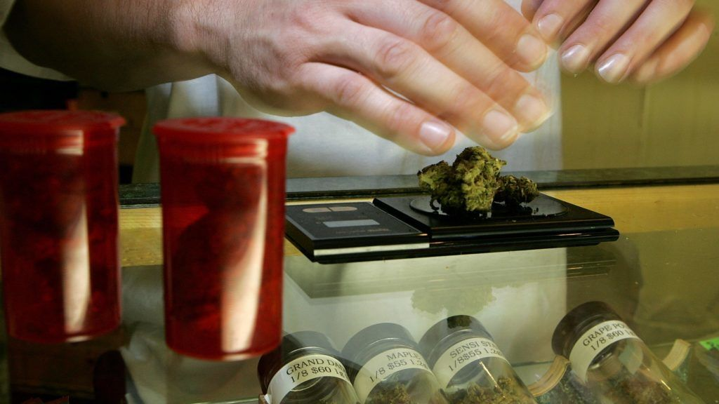(FILE PHOTO) The UK Home office announced on July 26,2018 that cannabis based medicine can be prescribed in the UK. SAN FRANCISCO - JULY 13: A worker at the Alternative Herbal Health Services cannabis dispensary weighs medicinal marijuana July 13, 2006 in San Francisco. San Francisco city planners are deciding July 13 if they will issue a permit to allow Kevin Reed to open the Green Cross medical marijuana dispensary right in the middle of San Francisco's Fisherman's Wharf area, a popular tourist destination.   Justin Sullivan/Getty Images/AFP