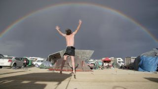 A visitor jumps when he sees a full rainbow at the 'Burning Man' festival area in the Navada desert near Black Rock City, United States, 29 August 2007. About 20 years ago, the 'Burning Man' festival was founded by Harvey when he inflamed a 2,40-metres-high wooden dummy at summer solstice out of lovesickness.The festival moved to the desert after San Francisco denied its approval. The mixture of Goa, Love Parade, Mad Max and Las Vegas attracted 50.000 visitors and developed to a 12,5-million-dollar business. Photo: Carolin Reiter