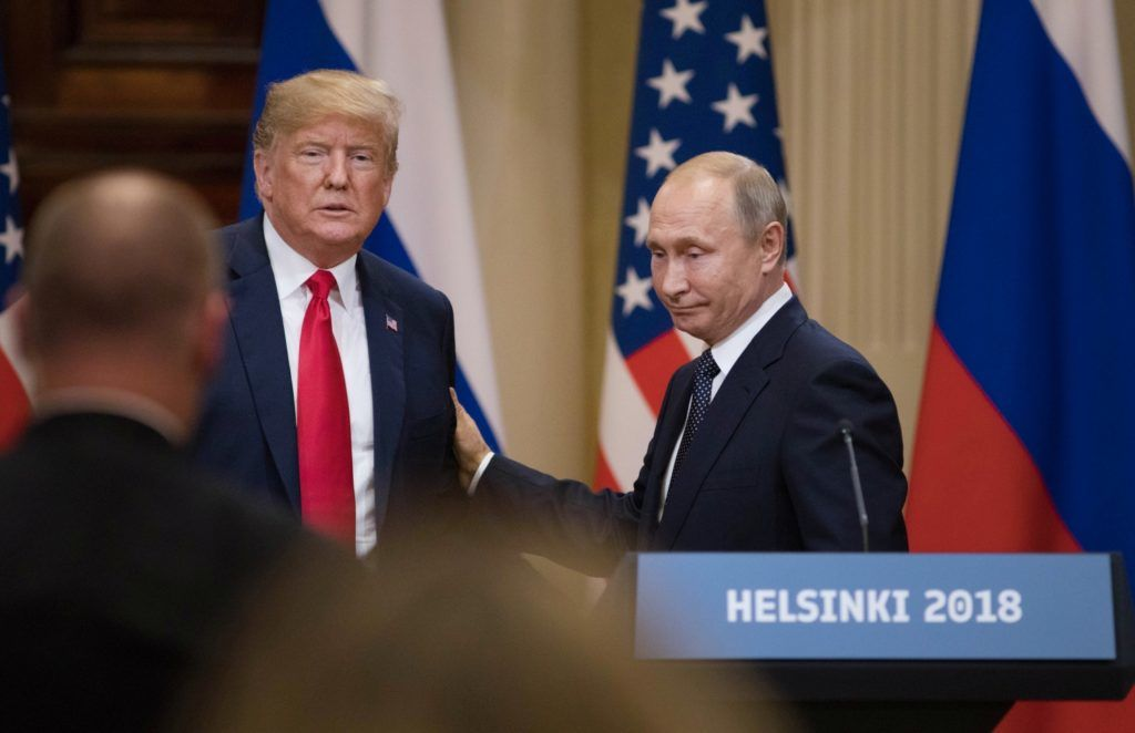 "U.S. President Donald Trump, left, and Vladimir Putin, Russia's president, prepare to leave following a news conference in Helsinki, Finland, on Monday, July 16, 2018. Trump called Special Counsel Robert Mueller's probe into Russian election meddling a ""disaster"" on Monday, again questioned whether Russia interfered in the 2016 election that he won and suggested he equally trusted his national intelligence director and Putin -- all as he stood next to the Russian leader. Photographer: Chris Ratcliffe/Bloomberg via Getty Images"
