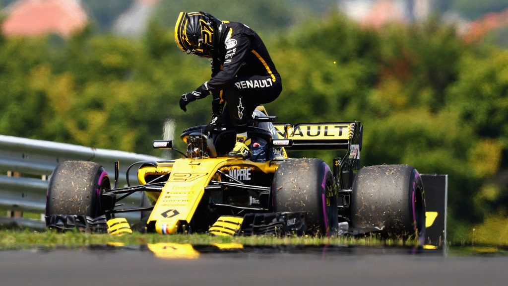 BUDAPEST, HUNGARY - JULY 27:  Nico Hulkenberg of Germany and Renault Sport F1 climbs from his car after stopping on track during practice for the Formula One Grand Prix of Hungary at Hungaroring on July 27, 2018 in Budapest, Hungary.  (Photo by Mark Thompson/Getty Images)