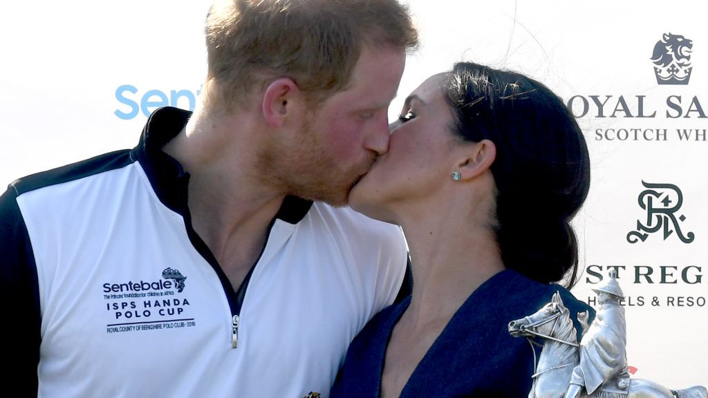 WINDSOR,  UNITED KINGDOM - JULY 26:    Meghan, Duchess of Sussex and Prince Harry, Duke of Sussex kiss as they pose with the trophy after the Sentebale ISPS Handa Polo at the Royal County of Berkshire Polo Club on July 26, 2018 in Windsor, England. (Photo by Anwar Hussein/WireImage)