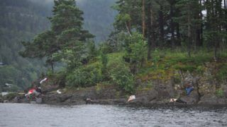 UTOYA ISLAND, NORWAY - JULY 22:  (NORWAY OUT) Victims lie on the banks following terror shootings at a summer youth camp on July 22, 2011 on Utoya Island, Norway. Reports suggest that at least 84 were killed when a lone gunman, reported to have links to right wing extremists, posed as a policeman as he attacked youths attending a summer political camp on the island. The attack has been connected to the earlier bomb explosion which targeted government offices in the centre of Oslo, in which a further 7 people are believed to have been killed. A man named as Anders Behring Breivik has been arrested and is being held as the primary suspect.  (Photo by Vegard M. Aas/presse30.no/Getty Images)