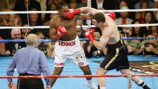 LOS ANGELES - JUNE 21: Vitali Klitschko (right) hits  Lennox Lewis during their WBC and IBO World Heavyweight Championship bout at the Staples Center on June 21, 2003 in Los Angeles, California.  Lennox Lewis (41-2-1) defeated Vitali Klitschko (32-2) by TKO in the sixth round.  (Photo by Jeff Gross/Getty Images)