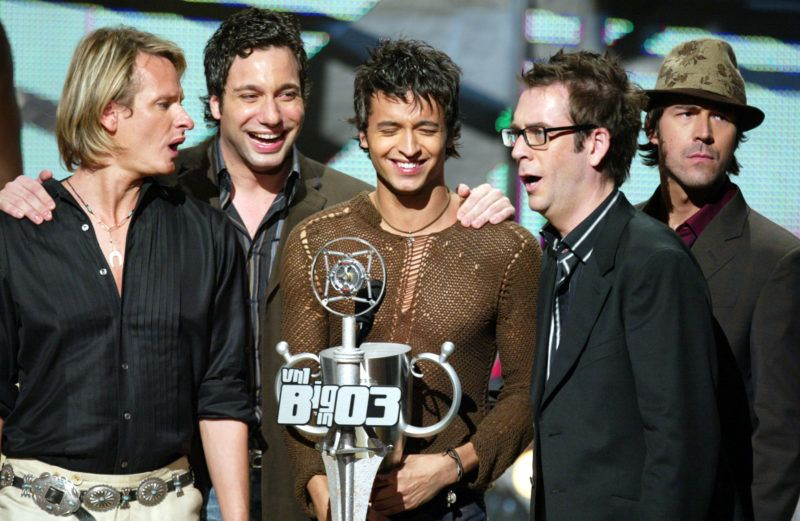 """LOS ANGELES - NOVEMBER 20:  (U.S. TABLOIDS OUT) The """"Fab Five"""", cast of """"Queer Eye for the Straight Guy"""", accepts the award for Biggest Gay Hero on stage at VH1's Big In 2003 Awards on November 20, 2003 at Universal City in Los Angeles, California.  VH1's Big in 2003 Awards will air in the U.S. on Sunday, November 30 at 9:00pm pst/et and will air in the U.K. on Friday, December 5 at 2100hrs. (Photo By Kevin Winter/Getty Images)"""