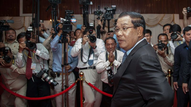 """PHNOM PENH, CAMBODIA - JULY 22:  Cambodian Prime Minister Hun Sen addresses the media before a meeting with Sam Rainsy, President of the opposition Cambodia National Rescue Party, aimed at resolving the year-long political deadlock on July 22, 2014 in Phnom Penh, Cambodia. Cambodian Prime Minister Hun Sen meets today with the President of the opposition Cambodia National Rescue Party, Sam Rainsy, for """"final talks"""" on an agreement to end the year-long political deadlock between the ruling Cambodian People's Party and the CNRP, a week after eight CNRP Members of Parliament-elect were arrested and charged with crimes of insurrection and incitement to violence. The deal on the table is based on a principle agreement dating back to April 2014 between Hun Sen and Sam Rainsy, which includes a February 2018 national election and reform of the National Election Committee.  (Photo by Omar Havana/Getty Images)"""