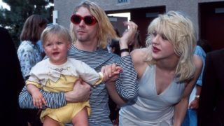 Kurt Cobain of Nirvana with wife Courtney Love and daughter Frances Bean Cobain at the Universal Ampitheater in Universal City, California (Photo by Kevin Mazur/WireImage)
