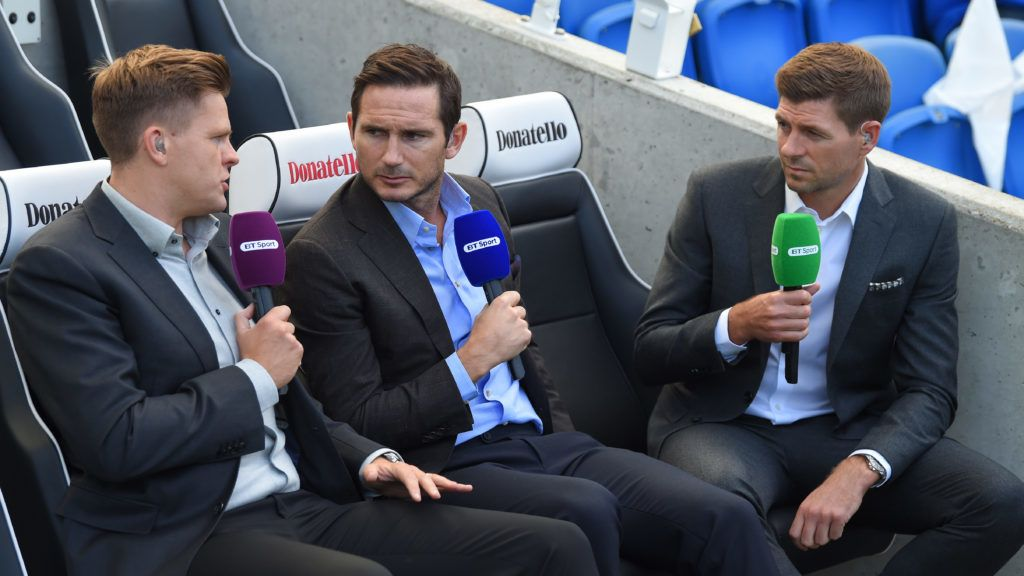 BRIGHTON, ENGLAND - AUGUST 12:  TV pundits Frank Lampard and Steven Gerrard chat to Jake Humphrey ahead of the Premier League match between Brighton and Hove Albion and Manchester City at Amex Stadium on August 12, 2017 in Brighton, England.  (Photo by Mike Hewitt/Getty Images)