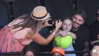 KEY BISCAYNE, FL - APRIL 01: David Beckham and his daughter  Harper pose for a photo while watching John Isner of the USA against  Alexander Zverev of Germany  in the men's final on Day 14 of the Miami Open Presented by Itau at Crandon Park Tennis Center on April 01, 2018 in Key Biscayne, Florida. (Photo by Mike Frey/Getty Images)
