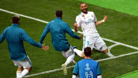 KIEV, UKRAINE - MAY 26:  Karim Benzema of Real Madrid celebrates scoring his side's first goal with team mates during the UEFA Champions League Final between Real Madrid and Liverpool at NSC Olimpiyskiy Stadium on May 26, 2018 in Kiev, Ukraine.  (Photo by Mike Hewitt/Getty Images)