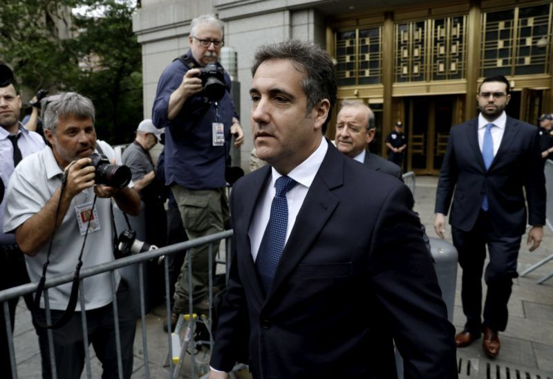 Michael Cohen, personal lawyer to U.S. President Donald Trump, center, exits federal court in New York, U.S., on Wednesday, May 30, 2018. Cohen said a recent bankruptcy court ruling againstMichael Avenatti's old law firm should disqualify the lawyer for Stormy Daniels from participating in a legal case over material seized from Cohen in an FBI raid. Photographer: Peter Foley/Bloomberg via Getty Images
