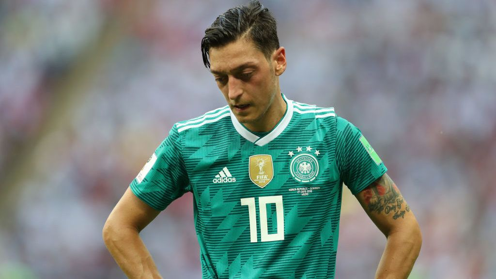 KAZAN, RUSSIA - JUNE 27:  Mesut Oezil of Germany stands dejected following the 2018 FIFA World Cup Russia group F match between Korea Republic and Germany at Kazan Arena on June 27, 2018 in Kazan, Russia.  (Photo by Catherine Ivill/Getty Images)
