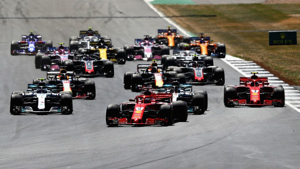 NORTHAMPTON, ENGLAND - JULY 08: Sebastian Vettel of Germany driving the (5) Scuderia Ferrari SF71H leads the field into turn one during the Formula One Grand Prix of Great Britain at Silverstone on July 8, 2018 in Northampton, England.  (Photo by Mark Thompson/Getty Images)