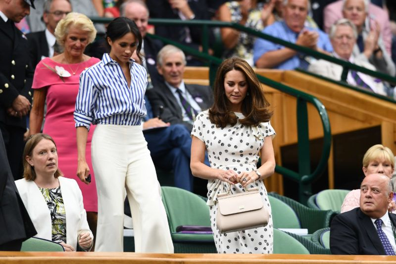LONDON, ENGLAND - JULY 14:  Catherine, Duchess of Cambridge (R) and Meghan, Duchess of Sussex attend day twelve of the Wimbledon Lawn Tennis Championships at All England Lawn Tennis and Croquet Club on July 14, 2018 in London, England.  (Photo by Clive Mason/Getty Images)