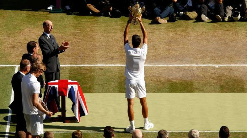 LONDON, ENGLAND - JULY 15: Novak Djokovic of Serbia lifts the trophy after winning Men's Singles final against Kevin Anderson of South Africa on day thirteen of the Wimbledon Lawn Tennis Championships at All England Lawn Tennis and Croquet Club on July 15, 2018 in London, England.  (Photo by Julian Finney/Getty Images)