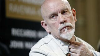 """US actor John Malkovich attends a press conference in Kyiv, Ukraine, 30 June,2018. John Malkovich and Riccardo will perform at a concert during the international project  """"The Roads of Friendship. Ravenna-Kiev"""" which will be held on the Sofia Square in Kiev on July 1.The 22nd event of the project that, since 1997, travels to places that have made history. Led by Riccardo Muti, the musicians of the Luigi Cherubini Youth Orchestra join the Orchestra and Choir of the National Opera of Ukraine, and also young artists from Mariupol, in Kiev, on the 1st of July ,and in Ravenna on the 3rd of July.The programme proposes Giuseppe Verdis music - from the """"Stabat Mater"""" and """"Te Deum"""" to """"Nabucco"""" - and Aaron Coplands """"Lincoln Portrait"""", featuring John Malkovich as the narrator.  (Photo by STR/NurPhoto via Getty Images)"""