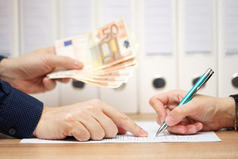 employer or businessman showing where to sign  in exchange to give money or severance