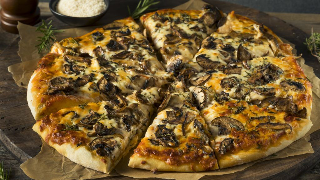 Gourmet Homemade Mushroom Pizza with Thyme and Rosemary