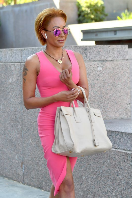 Mel B heads to the grove after a day in court with her ex husband Stephen Belaphonte. Mel wore a pink dress. 16 Jul 2018 Pictured: Mel B and Stephen Belafonte. Photo credit: Snorlax / MEGA  TheMegaAgency.com +1 888 505 6342 July , 2018  *** Local Caption *** MEGA253315_011