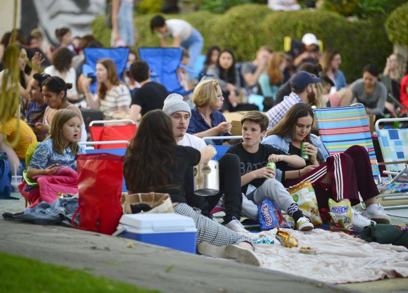 07/22/2018 EXCLUSIVE: Brooklyn Beckham takes his siblings and to an outdoor movie in Los Angeles. The family who were joined by some friends sat on beach chairs while enjoying a variety of snacks, including Twix, Hi Chew candy, Red Vines licorice, tortilla chips, and sipped on healthy La Croix seltzer, and Fiji water.