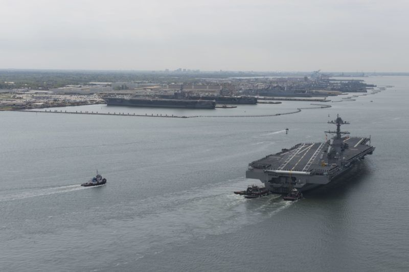 """This US Navy handout photograph shows the future USS Gerald R. Ford (CVN 78) arriving at Naval Station Norfolk in Virginia on April 14, 2017 approaching its berth next to the Nimitz-class aircraft carriers USS Dwight D. Eisenhower (CVN 69) and USS George Washington (CVN 73) after returning from Builder's Sea Trials and seven days underway.  During this initial at-sea period, Ford's crew, representatives from Huntington Ingalls Industries-Newport News Shipbuilding, the Navy's CVN 78 Program Office, the Navy's Supervisor of Shipbuilding, Conversion and Repair and various technical subject matter experts demonstrated many of the ship's key systems. Primary risk reduction objectives were successfully met, and, as is typical with sea trials, the Navy and shipbuilder learned a great deal about the ship's performance during the extensive testing. Analysis continues, and any identified corrective actions will be addressed. CVN 78 remains on track to conduct Acceptance Trials and delivery to the Navy this spring.  / AFP PHOTO / Navy Office of Information / MC2 Ridge Leoni / XGTY  == RESTRICTED TO EDITORIAL USE  / MANDATORY CREDIT:  """"AFP PHOTO / US NAVY /  MC2 RIDGE LEONI"""" / NO MARKETING / NO ADVERTISING CAMPAIGNS /  DISTRIBUTED AS A SERVICE TO CLIENTS  =="""