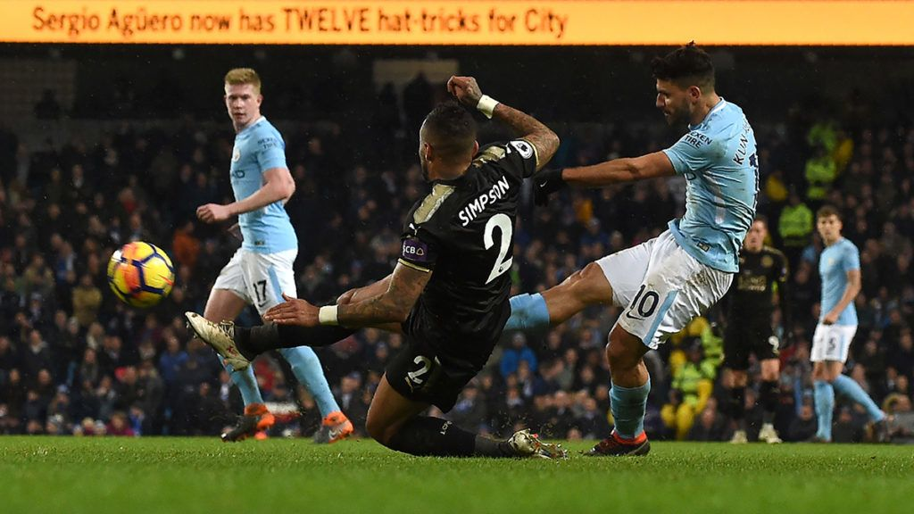 Manchester City's Argentinian striker Sergio Aguero (R) shoots to score their fifth goal, his fourth during the English Premier League football match between Manchester City and Leicester City at the Etihad Stadium in Manchester, north west England, on February 10, 2018.Manchester City won the game 5-1. / AFP PHOTO / PAUL ELLIS / RESTRICTED TO EDITORIAL USE. No use with unauthorized audio, video, data, fixture lists, club/league logos or 'live' services. Online in-match use limited to 75 images, no video emulation. No use in betting, games or single club/league/player publications.  /